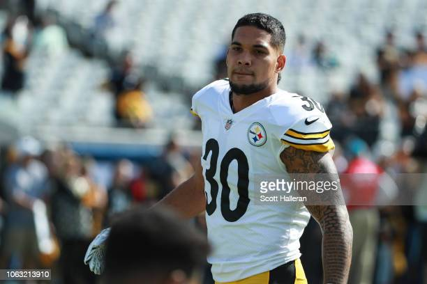 James Conner of the Pittsburgh Steelers warms up before the game between the Jacksonville Jaguars and the Pittsburgh Steelers at TIAA Bank Field on...