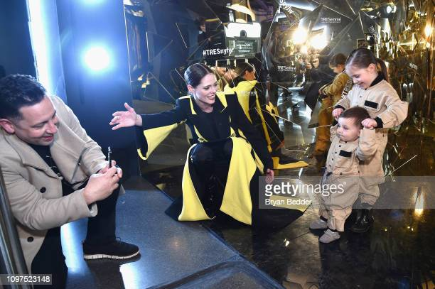 James Conran, Coco Rocha and their children Iver Eames Conran and Ioni James Conran visit the photo booth in The Tresemmé Salon during New York...