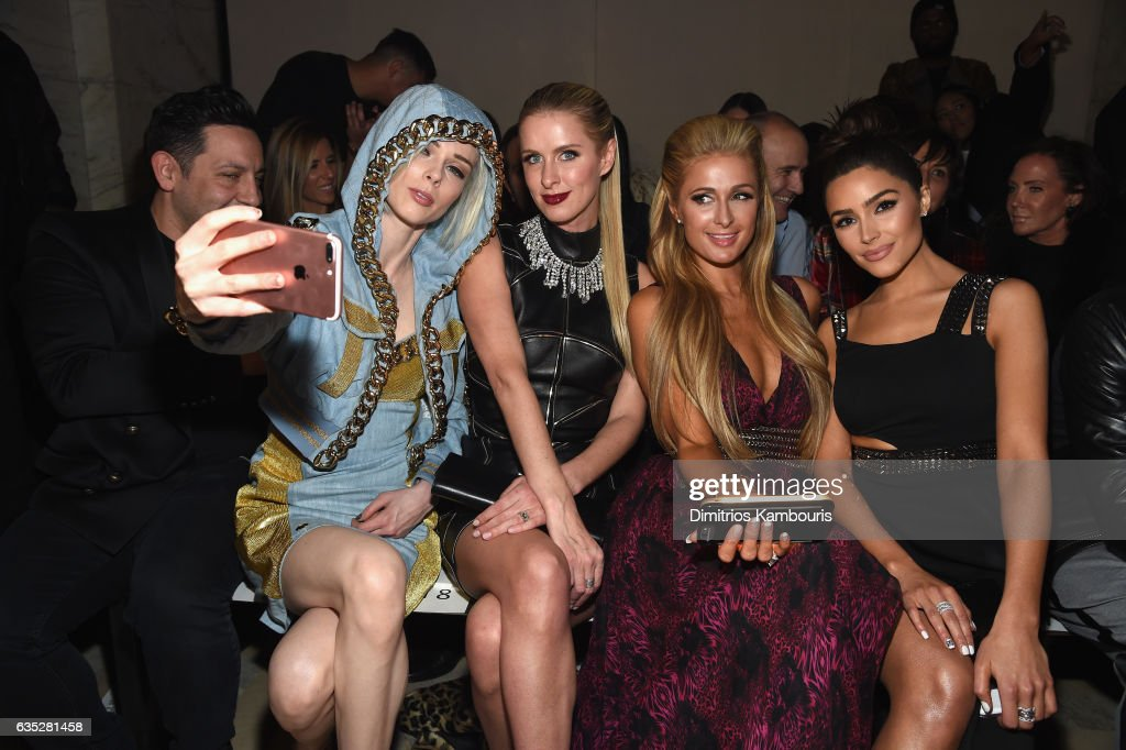 James Conran, Coco Rocha, Nicky Hilton Rothschild, Paris Hilton, and Olivia Culpo attend the Front Row for the Philipp Plein Fall/Winter 2017/2018 Women's And Men's Fashion Show at The New York Public Library on February 13, 2017 in New York City.