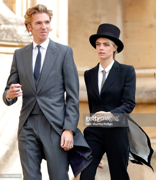James Cook and Cara Delevingne attend the wedding of Princess Eugenie of York and Jack Brooksbank at St George's Chapel on October 12 2018 in Windsor...
