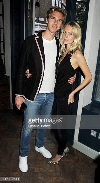 James Cook and Poppy Delevingne attend the Willow Resort Party hosted by Kit Willow and Poppy Delevingne at The Riding House Cafe on June 22 2011 in...