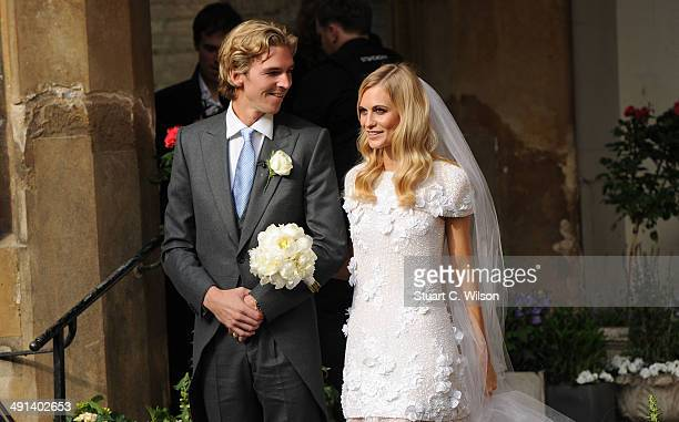 James Cook and Poppy Delevingne depart St Pauls Church in Knighstbridge after thier wedding on May 16 2014 in London England