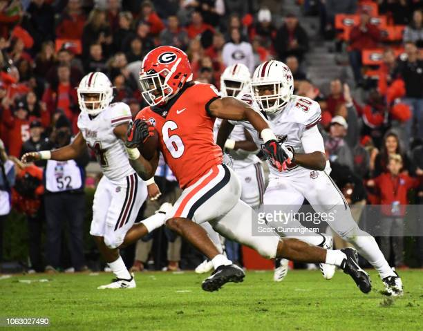 James Cook of the Georgia Bulldogs carries the ball for a third quarter touchdown against the Massachusetts Minutemen on November 17 2018 at Sanford...