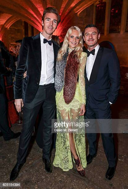 James Cook Poppy Delevingne and Luke Evans attends the Save The Children Winter Gala at The Guildhall on November 22 2016 in London England