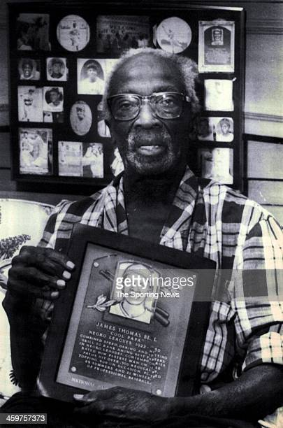 """James """"Cool Papa"""" Bell holds picture of his Hall of Fame a plaque talking about his playing days with the Negro League on February 1990. Bell a..."""