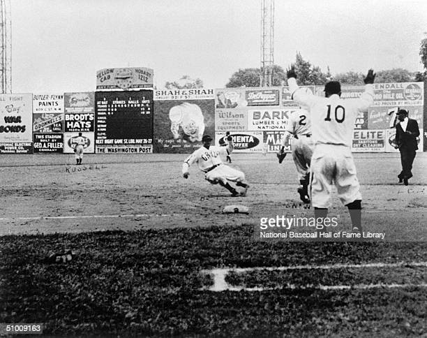 James 'Cool Papa' Bell of the Homestead Grays slides to avoid the tag during a Negro League game in Washington DC Cool Papa played for the Grays in...