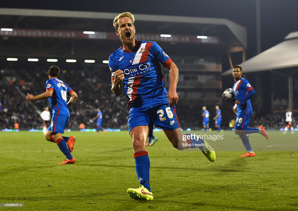 James Coppinger of Doncaster celebrates after scoring during the Capital One Cup Third Round match between Fulham and Doncaster Rovers at Craven Cottage on September 23, 2014 in London, England.