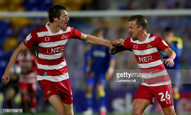 James Coppinger of Doncaster Rovers celebrates after scoring his sides second goal during the Sky Bet League One match between AFC Wimbledon and...