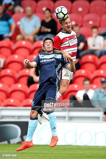 James Coppinger of Doncaster Rovers heads the ball over Carlos de Pena of Middlesbrough FC during the preseason friendly match between Doncaster...