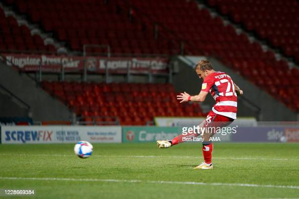 James Coppinger of Doncaster Rovers takes his penalty during the EFL Trophy match between Doncaster Rovers v Bradford City at Keepmoat Stadium on...