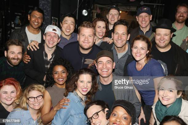 James Corden and Paul Rudd pose with the cast backstage at the hit musical based on the film Groundhog Day on Broadway at The August Wilson Theatre...