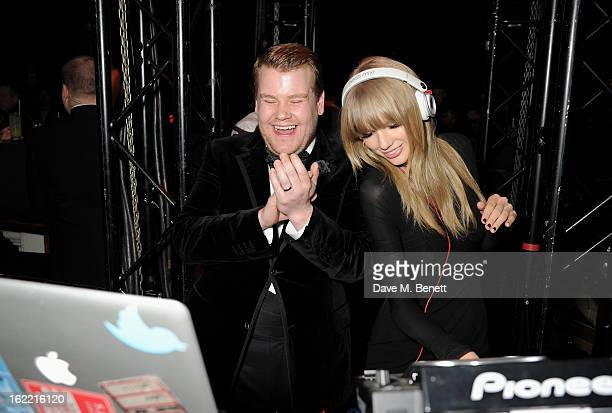 James Corden and Taylor Swift DJ at the Universal Music Brits Party hosted by Bacardi at the Soho House popup on February 20 2013 in London England