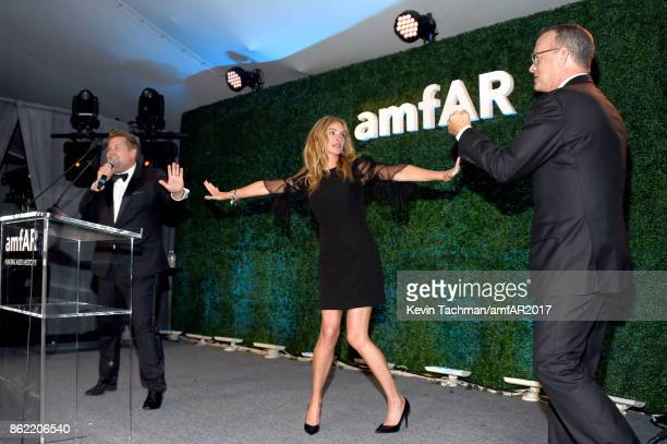 James Corden Julia Roberts and Tom Hanks onstage at amfAR Los Angeles 2017 at Ron Burkle's Green Acres Estate on October 13 2017 in Beverly Hills...