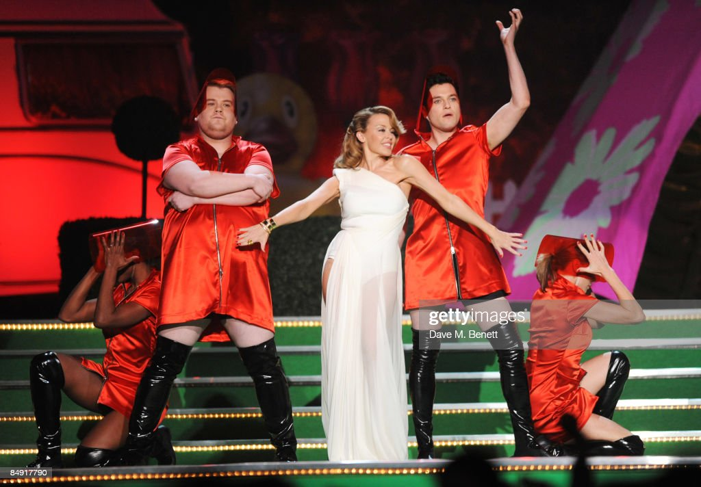 James Corden, Kylie Minogue and Mathew Horne perform on stage during The Brit Awards 2009, at Earls Court One on February 18, 2009 in London, England.