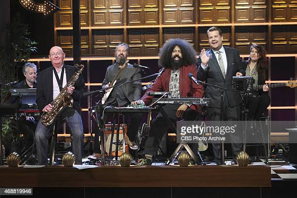James Corden Reggie Watts and the band Tim Young Guillermo Brown Hagar Ben Ari and Steve Scalfati play with Corden's father Malcolm Corden on The...