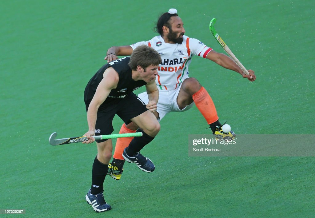 James Coughlan of New Zealand and Sardar Singh of India collide as they contest for the ball during the match between New Zealand and India during day two of the Champions Trophy on December 2, 2012 in Melbourne, Australia.