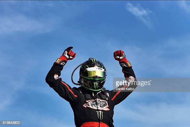 James Courtney driver of the Holden Racing Team Holden Commodore VF reacts in parc ferme after winning race 2 for the V8 Supercars Clipsal 500 at...