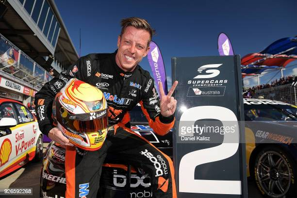 James Courtney driver of the Mobil 1 Boost Mobile Racing Holden Commodore ZB celebrates after finishing second during race 1 for the Supercars...