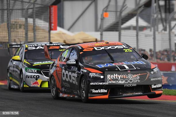 James Courtney drives the Mobil 1 Boost Mobile Racing Holden Commodore ZB leads Craig Lowndes drives the Autobarn Lowndes Racing Holden Commodore ZB...
