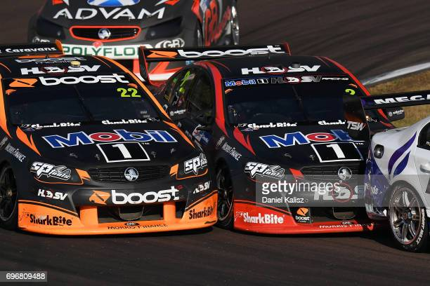 James Courtney drives the Mobil 1 HSV Racing Holden Commodore VF Scott Pye drives the Mobil 1 HSV Racing Holden Commodore VF during race 11 for the...