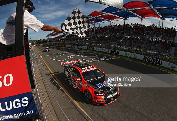 James Courtney driving the Holden Racing Team Holden takes the chequered flag to win race two for the V8 Supercars Clipsal 500 at Adelaide Street...