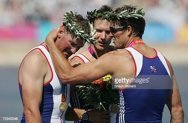 James Cracknell goes to embrace a tearful Matthew Pinsent of Great Britain after the medal ceremony for the men's four rowing event on August 21 2004...