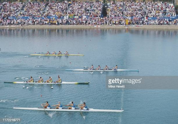 James Cracknell, Steve Redgrave, Tim Foster and Matthew Pinsent of Great Britain cross the finish line to win gold ahead of Italy and Australia in...