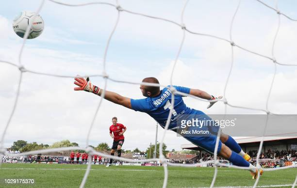 James Craigen of Denfermline scores his penalty during the shootout during the Scottish Challenge Cup match between Boreham Wood and Dunfirmline at...