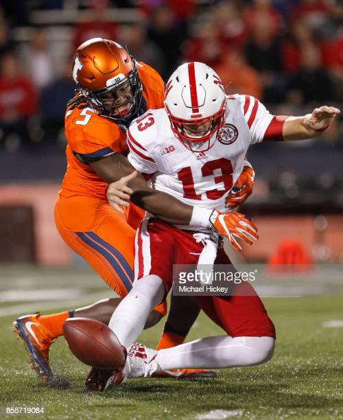 James Crawford of the Illinois Fighting Illini makes the sack on Tanner Lee of the Nebraska Cornhuskers as he fumbles the football at Memorial...