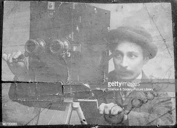 James Crawley operating a FrieseGreene stereoscopic cine camera c 1895 William Friese Greene camera manufacturer and photographer was involved in the...