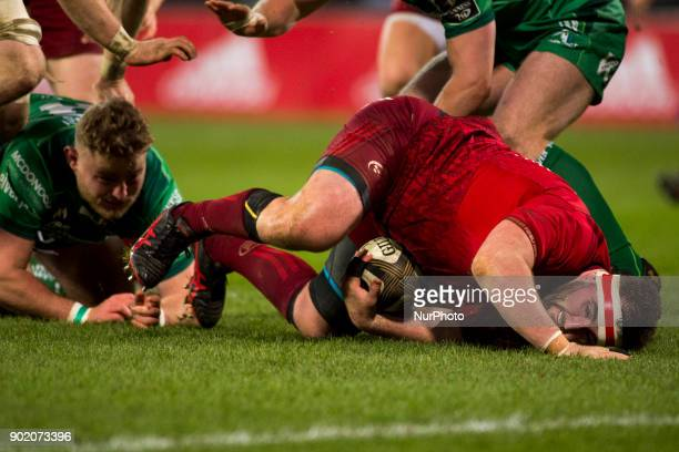 James Cronin of Munster tackled by Finlay Bealham of Connacht during the Guinness PRO14 Round 13 rugby match between Munster Rugby and Connacht Rugby...