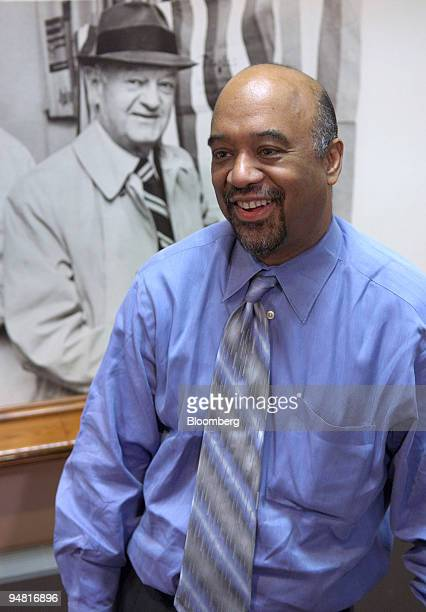 James Cruchfield publisher of the Akron Beacon Journal smiles during an interview in the Beacon Journal Journal offices with a photograph of John S...