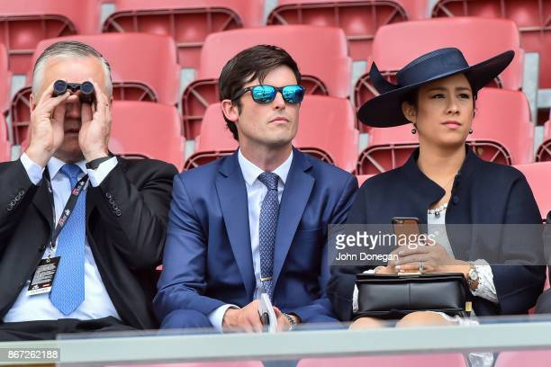 James Cummings in the middle watches the Strathmore Community Bendigo Bank Handicap that was won by Gun Case at Moonee Valley Racecourse on October...