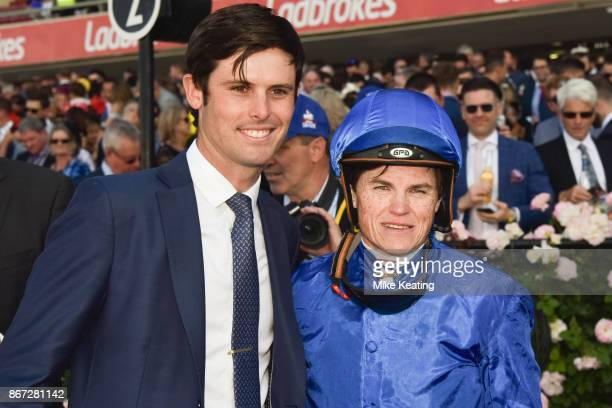 James Cummings with Craig Williams after Banish won the italktravel Fillies Classic at Moonee Valley Racecourse on October 28 2017 in Moonee Ponds...