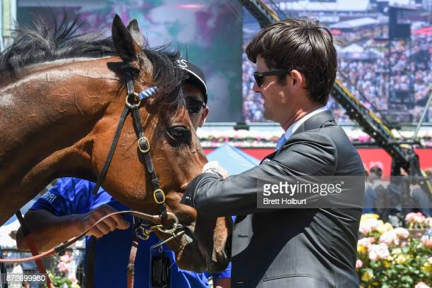 James Cummings with Moher after winning the Sensis Digital Trophy at Flemington Racecourse on November 11 2017 in Flemington Australia