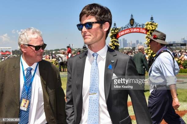 James Cummings with stable foreman Reg Flemming after Moher won the Sensis Digital Trophy at Flemington Racecourse on November 11 2017 in Flemington...