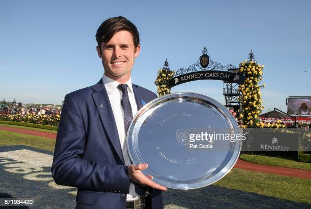 James Cummings with the trophy after Jorda won the Kennedy Plate at Flemington Racecourse on November 09 2017 in Flemington Australia