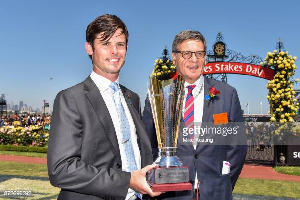 James Cummings with the trophy after Moher won the Sensis Digital Trophy at Flemington Racecourse on November 11 2017 in Flemington Australia