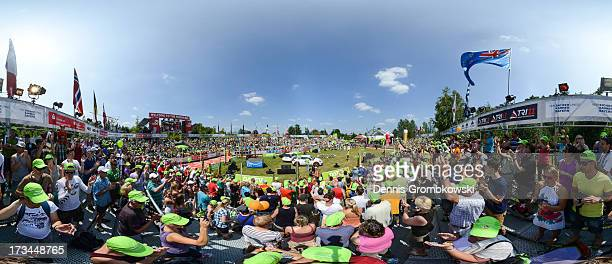 James Cunnama of South Africa enters the main stadium to finish second during the DATEV Challenge Roth Triathlon on July 14 2013 in Roth Germany