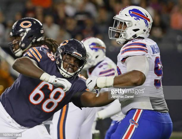 James Daniels of the Chicago Bears blocks Adolphus Washington of the Buffalo Bills during a preseason game at Soldier Field on August 30 2018 in...
