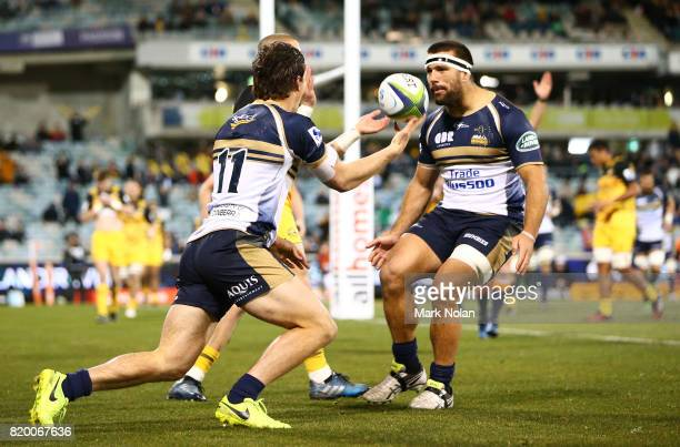 James Dargaville of the Brumbies celebrates an early try with team mates during the Super Rugby Quarter Final match between the Brumbies and the...