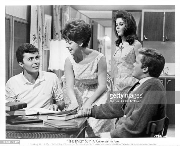 James Darren, Pamela Tiffin, Doug McClure and Joanie Sommers at the breakfast table scene from the film 'The Lively Set', 1964.