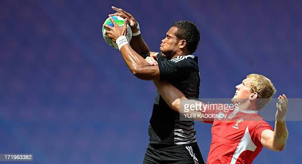 James Davies of Wales vies with Tomasi Cama of New Zealand during their quarter final match at the 2013 Rugby World Cup Sevens in Moscow on June 30...