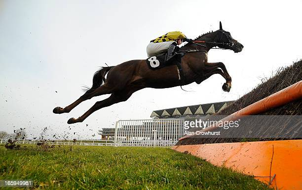 James Davies riding Escort'Men clear a fence in The BMW Ascot Novices' Handicap Steeple Chase at Ascot racecourse on April 07 2013 in Ascot England