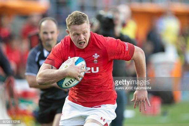 James Davies runs with the ball during an International Test Match between Argentina and Wales at the San Juan del Bicentenario Stadium on Saturday...