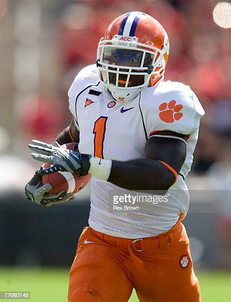 James Davis of the Clemson Tigers carries the ball against the NC State Wolfpack at Carter Finley Stadium on September 22, 2007 in Raleigh, North...