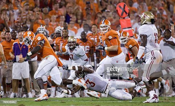 James Davis of the Clemson Tigers drags Myron Rolle of the Florida State Seminoles as he picks up a first down during the first half at Memorial...