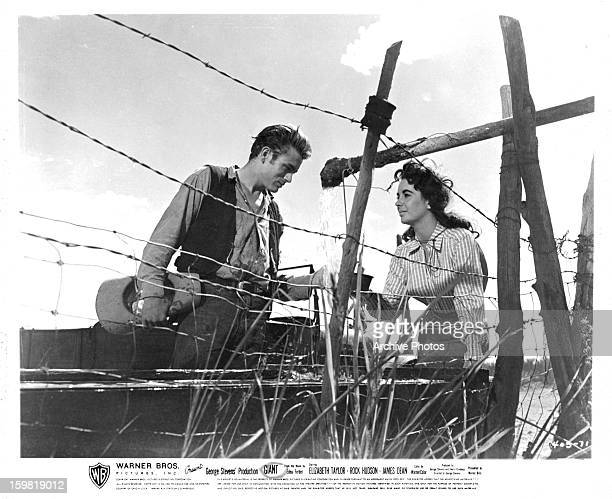 James Dean and Elizabeth Taylor getting water together in a scene from the film 'Giant' 1956