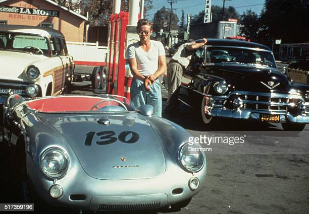 James Dean at a gas station with his silver Porsche 550 Spyder he named Little Bastard just hours before his fatal crash