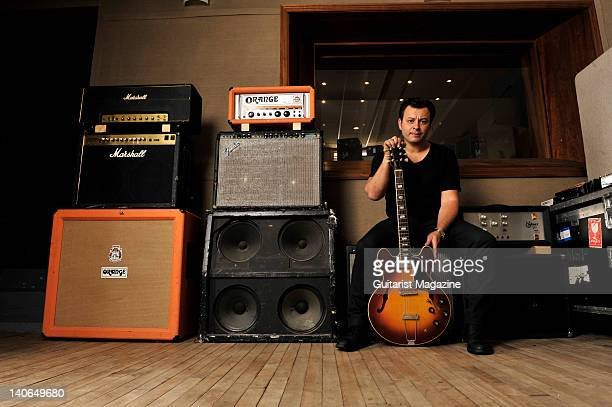 James Dean Bradfield from the band Manic Street Preachers sat amongst a set of amplifiers holding a 1969 Gibson ES330 guitar During an interview on...